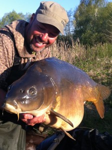 'A recent upper fifty from France. Caught by accurate casting and baiting to the base of a feature against the weed'